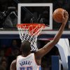 Oklahoma City \'s Kevin Durant (35) dunks during an NBA basketball game between the Oklahoma City Thunder and the Golden State Warriors at Chesapeake Energy Arena in Oklahoma City, Sunday, Nov. 18, 2012. Photo by Garett Fisbeck, The Oklahoman