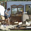Kristi McDaniel-Edwards looks for items at the home of her grandmother Louise McDaniel\'s as residents cleanup following Tuesday\'s deadly tornado on Wednesday, May 25, 2011, in Chickasha, Okla. Louise was with her hospitalized son Ronnie McDaniel in Oklahoma City when the tornado destroyed her home. Louise McDaniel saw the destruction and recognized her yard from aerial television coverage. Photo by Steve Sisney, The Oklahoman
