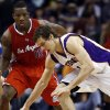 Phoenix Suns\' Goran Dragic, right, of Slovenia, tries to control the ball in front of Los Angeles Clippers\' Eric Bledsoe (12) during the first half of an NBA basketball game, Thursday, Jan. 24, 2013, in Phoenix. (AP Photo/Ross D. Franklin)