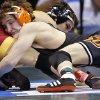 Oklahoma State\'s Anthony Collica takes on Iowa State\'s Gabe Moreno in the 141 pound match during the 2014 NCAA Div. 1 Wrestling Championships at Chesapeake Energy Arena in Oklahoma City, Okla. on Friday, March 21, 2014. Photo by Chris Landsberger, The Oklahoman