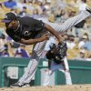 Photo - Colorado Rockies starting pitcher Juan Nicasio follows through on a pitch against the Chicago White Sox in the fifth inning of a spring exhibition baseball game Tuesday, March 25, 2014, in Glendale, Ariz. (AP Photo/Mark Duncan)