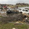 Cars destroyed by the May 20th tornado were tossed into the pond near Briarwood School in Moore, OK, Saturday, May 25, 2013, Photo by Paul Hellstern, The Oklahoman