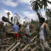 Relatives continue to search for their missing kin following a flash flood brought by Tuesday\'s Typhoon Bopha at New Bataan township, Compostela Valley in southern Philippines Friday Dec. 7, 2012. Rescuers were digging through mud and debris Friday to retrieve more bodies strewn across a farming valley in the southern Philippines by a powerful typhoon. (AP Photo/Bullit Marquez)