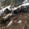 Photo - This photo released by the San Miguel Sheriff's Office shows the wreckage of a private Beechcraft Bonanza single-engine plane that crashed near a Colorado ski town's airport, killing all three people aboard. Sheriff's spokeswoman Jennifer Dinsmore said deputies began the recovery effort west of Telluride, Colo., Monday Feb. 17, 2014. The airplane took off from Telluride Regional Airport on Sunday, Feb. 16 on its way to Cortez, a city in southwest Colorado about 75 miles away. (AP Photo/San Miguel Sheriff's Office)