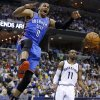 Oklahoma City\'s Russell Westbrook (0) celebrates as he comes down from a dunk in front of Memphis\' Mike Conley (11) during Game 6 in the first round of the NBA playoffs between the Oklahoma City Thunder and the Memphis Grizzlies at FedExForum in Memphis, Tenn., Thursday, May 1, 2014. Photo by Bryan Terry, The Oklahoman