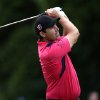 Photo - Ireland's Padraig Harrington watches his second shot on the second, during day three of the 2014 Irish Open at Fota Island Resort, County Cork, Ireland, Saturday, June 21, 2014. (AP Photo/Brian Lawless, PA Wire)    UNITED KINGDOM OUT   -   NO SALES   -   NO ARCHIVES