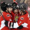 Photo - Ottawa Senators' Daniel Alfredsson, center, celebrates his second-period goal against the Carolina Hurricanes with teammates Chris Phillips, left, and Kyle Turris, right, during NHL hockey game action in Ottawa, Thursday, Feb. 7, 2013. (AP Photo/The Canadian Press, Fred Chartrand)