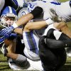 Deer Creek\'s Jackson Smith is brought down by Guthrie\'s Deshawdre Dillard, bottom, and Beau Davis during their high school football game at Deer Creek in Oklahoma City, Friday, October 25, 2013. Photo by Bryan Terry, The Oklahoman