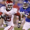 Oklahoma\'s Ryan Broyles (85) makes a touchdown reception in front of Kansas\'s Tyler Patmon (33) during the college football game between the University of Oklahoma Sooners (OU) and the University of Kansas Jayhawks (KU) on Saturday, Oct. 15, 2011. in Lawrence, Kan. Photo by Chris Landsberger, The Oklahoman
