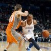 Photo - Oklahoma City's Russell Westbrook (0) tries to get past Phoenix's Steve Nash (13) during the NBA game between the Oklahoma City Thunder and the Phoenix Suns, Sunday, March 6, 2011, the Oklahoma City Arena. Photo by Sarah Phipps, The Oklahoman.