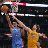 Oklahoma City\'s Russell Westbrook (0) shoots over Los Angeles\' Pau Gasol (16) during Game 3 in the second round of the NBA basketball playoffs between the L.A. Lakers and the Oklahoma City Thunder at the Staples Center in Los Angeles, Friday, May 18, 2012. Photo by Nate Billings, The Oklahoman