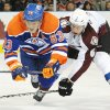 Colorado Avalanche\'s Bryan Allen, right, trips Edmonton Oilers\' Ales Hemsky during the first period of an NHL hockey game in Edmonton, Alberta, on Friday, Dec. 9, 2011. (AP Photo/The Canadian Press, John Ulan)