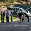 Photo - Investigators examine a van that was driven by the former TSA worker, Nna Alpha Onuoha, 29, when he was arrested on suspicion of making threats related to the anniversary of the 9/11 terriorist attacks,  on Wednesday, Sept. 11, 2013, in Riverside, Calif. Alpha Onuoha, 29, was arrested shortly before midnight Tuesday east of Los Angeles in Riverside, and he remained in custody on suspicion of making threats pending additional investigation. (AP Photo/The Press-Enterprise, Kurt Miller)  NO SALES; MAGS OUT; MANDATORY CREDIT