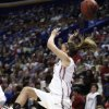 A cross court pass sails over the head of Jenny Vining in the first half as the University of Oklahoma plays Louisville at the 2009 NCAA women\'s basketball tournament Final Four in the Scottrade Center in Saint Louis, Missouri on Sunday, April 5, 2009. Photo by Steve Sisney, The Oklahoman