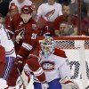 Photo - Phoenix Coyotes' Lauri Korpikoski, left, of Finland, deflects the puck past Montreal Canadiens' Peter Budaj, right, of the Czech Republic, for a goal during the first period of an NHL hockey game on Thursday, March 6, 2014, in Glendale, Ariz. (AP Photo/Ross D. Franklin)