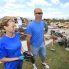 TORNADO / DAMAGE / AFTERMATH / CLEAN UP / HOUSE: Tornado aftermath cleanup east of Piedmont, Wednesday, May 25, 2011. Duane Johnson and wife Tiffany look over their home that was hit by a tornado Tuesday evening. Photo by David McDaniel, The Oklahoman ORG XMIT: KOD