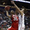Whitney Hand defends Angel McCoughtry (35) in the first half as the University of Oklahoma plays Louisville at the 2009 NCAA women\'s basketball tournament Final Four in the Scottrade Center in Saint Louis, Missouri on Sunday, April 5, 2009. Photo by Steve Sisney, The Oklahoman