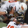 Oklahoma State\'s Jamie Blatnick (50, Wilson Youman (86) and Caleb Lavey (45) tackle Missouri\'s Henry Josey (20) during a college football game between the Oklahoma State University Cowboys (OSU) and the University of Missouri Tigers (Mizzou) at Faurot Field in Columbia, Mo., Saturday, Oct. 22, 2011. Photo by Sarah Phipps, The Oklahoman