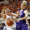 OSU\'s Lindsey Keller (25) and James Madison\'s Nikki Newman (30) battle for the ball during the Women\'s NIT championship college basketball game between Oklahoma State University and James Madison at Gallagher-Iba Arena in Stillwater, Okla., Saturday, March 31, 2012. OSU won, 75-68. Photo by Nate Billings, The Oklahoman