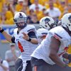 Oklahoma State Quarterback J.W. Walsh (4) attempts a pass during the third quarter of an NCAA college football game against West Virginia in Morgantown, W.Va., on Saturday, Sept. 28, 2013. (AP Photo/Tyler Evert) ORG XMIT: WVTE109