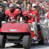 Photo - Ohio State quarterback Braxton Miller, left, is carted off the field after being injured during the first quarter against San Diego State in an NCAA college football game Saturday, Sept. 7, 2013, in Columbus, Ohio. (AP Photo/Jay LaPrete)