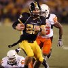 Photo - COLLEGE FOOTBALL: Missouri quarterback Chase Daniel (wearing number 25) runs past Orie Lemon (41) and Quinton Moore (26) in the first half as Oklahoma State University Cowboys (OSU) plays the University of Missouri Tigers (MIZZOU) at Faurot Field in Columbia, Mo. on Saturday October 11, 2008.  BY STEVE SISNEY, THE OKLAHOMAN    ORG XMIT: KOD