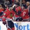 Chicago Blackhawks\' Brandon Saad (20) is congratulated by Andrew Shaw after scoring a goal against the Nashville Predators during the first period of an NHL hockey game Friday, April 19, 2013, in Chicago. (AP Photo/Jim Prisching)