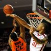 Photo - Oklahoma forward D.J. Bennett (31), blocks a shot by Oklahoma State guard Markel Brown during the first half of an NCAA college basketball game in Norman, Okla., Monday, Jan. 27, 2014. (AP Photo/Brody Schmidt)