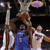 Oklahoma City\'s Kendrick Perkins (5) goes to the basket between Miami\'s LeBron James, left, and Shane Battier during Game 3 of the NBA Finals between the Oklahoma City Thunder and the Miami Heat at American Airlines Arena, Sunday, June 17, 2012. Photo by Bryan Terry, The Oklahoman