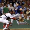 Tampa Bay Rays\' Luke Scott beats the throw into Boston Red Sox catcher Jarrod Saltalamacchia as he scores on a single by James Loney during the eighth inning of a baseball game at Fenway Park in Boston Wednesday, July 24, 2013. (AP Photo/Elise Amendola)
