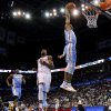 Andre Iguodala (9) dunks the ball in front of Oklahoma City\'s Kevin Durant (35) during an NBA basketball game between the Oklahoma City Thunder and the Denver Nuggets at Chesapeake Energy Arena in Oklahoma City, Tuesday, March 19, 2013. Denver won 114-104. Photo by Bryan Terry, The Oklahoman