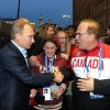 Photo - Russian President Vladimir Putin, left, shakes hands with Chairman of the Canadian National Olympic Committee Marcel Aubut at Canada House during the 2014 Winter Olympics, Friday, Feb. 14, 2014 in Sochi, Russia. (AP Photo/RIA-Novosti, Mikhail Klimentyev, Presidential Press Service)