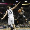 Photo - Sacramento Kings guard Marcus Thornton, right, drives past Memphis Grizzlies center Marc Gasol (33), of Spain, in the first half of an NBA basketball game on Friday, Jan. 17, 2014, in Memphis, Tenn. (AP Photo/Lance Murphey)