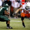 Brandon Whitaker (2) is stopped for no gain by Nathan Peterson during first half action in the college football game between Oklahoma State University and Baylor University at Floyd Casey Stadium in Waco, Texas, Saturday, Nov. 17, 2007. BY STEVE SISNEY, THE OKLAHOMAN