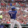 Texas Rangers\' Elvis Andrus his a two-run single during the second inning of a baseball game against the St. Louis Cardinals, Friday, June 21, 2013, in St. Louis. (AP Photo/Jeff Roberson)