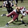 Wynnewood\'s Gus Reinert (14) keeps his balance and recovers to score on this pass play defended by Wayne\'s Charlie Garnder in high school Football on Friday, Oct. 26, 2012 in Wayne, Okla. Photo by Steve Sisney, The Oklahoman