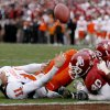 OSU\'s Zach Robinson fumbles the ball after being hit by OU\'s Curtis Lofton, center, and DeMarcus Granger during the first half of the college football game between the University of Oklahoma Sooners (OU) and the Oklahoma State University Cowboys (OSU) at the Gaylord Family-Memorial Stadium on Saturday, Nov. 24, 2007, in Norman, Okla. Photo By Bryan Terry, The Oklahoman