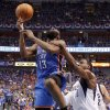 Oklahoma City\'s James Harden (13) is fouled by Dallas\' Ian Mahinmi (28) during Game 4 of the first round in the NBA playoffs between the Oklahoma City Thunder and the Dallas Mavericks at American Airlines Center in Dallas, Saturday, May 5, 2012. Photo by Bryan Terry, The Oklahoman