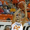 Oklahoma State\'s Brittney Martin (22) shoots a basket in front of Kansas\' Monica Engelman (13) during a women\'s college basketball game between Oklahoma State University (OSU) and Kansas at Gallagher-Iba Arena in Stillwater, Okla., Tuesday, Jan. 8, 2013. Oklahoma State won 76-59. Photo by Bryan Terry, The Oklahoman