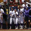 LSU\'s A.J. Andrews (6) celebrates with her teammates during a Women\'s College World Series game between Louisiana State University and the University of South Florida at ASA Hall of Fame Stadium in Oklahoma City, Saturday, June 2, 2012. Photo by Garett Fisbeck, The Oklahoman