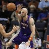 Phoenix Suns\' Marcin Gortat (4), of Poland, ouls Memphis Grizzlies\' Rudy Gay during the first half of an NBA basketball game in Memphis, Tenn., Tuesday, Dec. 4, 2012. (AP Photo/Danny Johnston)