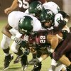 Memorial\'s Anthony Morales (22) is tackled by Santa Fe\'s, from left, Tim Johnson, Johnathan Allen and Trevor Pletcher in the second quarter during the high school football game between Edmond Memorial and Edmond Sante Fe at Wantland Stadium in Edmond, Okla., Friday, Sept. 12, 2008. BY MATT STRASEN, THE OKLAHOMAN