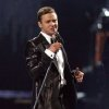 """Photo - FILE - This Feb. 20, 2013 file photo shows Justin Timberlake during the BRIT Awards 2013 in London.  Nielsen SoundScan announced Tuesday, March 26, 2013, that the singer's third album, """"The 20/20 Experience,"""" has moved 968,000 units. It's the 19th album in Nielsen's 12-year history that has sold more than 900,000 albums in a single week. (Photo by Joel Ryan/Invision/AP, file)"""