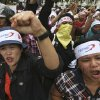 Photo -   Factory workers shout slogans during a protest in medan, North Sumatra, Indonesia, Wednesday, Oct. 3, 2012. Indonesian unions said more than 2 million factory workers have gone on a one-day strike across the country to call for higher wages and protest the hiring of contract workers. (AP Photo/Binsar Bakkara)