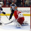 Photo - Buffalo Sabres' Tyler Ennis (63) shoots the puck past Carolina Hurricanes goalie Cam Ward (30) to score on a penalty shot during the first period of an NHL hockey game in Raleigh, N.C., Thursday, March 13, 2014. (AP Photo/Karl B DeBlaker)