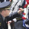 Oklahoma City Police Officer Chad Peery places a rose on a wreath during the Oklahoma Law Enforcement Officers Memorial Service in Oklahoma City, Friday, May 18, 2012. Photo By Steve Gooch, The Oklahoman