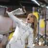 FILE - In this Sunday, Feb. 10, 2013 file photo, Taylor Swift performs on stage at the 55th annual Grammy Awards in Los Angeles. Swift is a nominee with five nominations at the upcoming 48th annual Academy of Country Music Awards. The show will broadcast live on CBS from the MGM Grand Garden Arena in Las Vegas on Sunday, April, 8, 2013. (Photo by John Shearer/Invision/AP, File)
