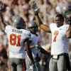 Oklahoma State\'s Michael Harrison (7) and Justin Blackmon (81) celebrate after an official\'s review changed a call of an incomplete pass into a touchdown catch by Blackmon in the third quarter Saturday. Photo by Nate Billings, The Oklahoman