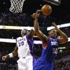 Phoenix Suns\' Jermaine O\'Neal (20) blocks the shot of Philadelphia 76ers\' Lavoy Allen (50) during the first half of an NBA basketball game on Wednesday, Jan. 2, 2013, in Phoenix. (AP Photo/Ross D. Franklin)