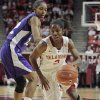 Oklahoma Sooners\' Aaryn Ellenberg (3) dribbles past Delisa Gross as the University of Oklahoma (OU) Sooners play the Texas Christian University (TCU) Horned Frogs in women\'s college basketball at the Lloyd Noble Center on Wednesday, Dec. 28, 2011, in Norman, Okla. Photo by Steve Sisney, The Oklahoman